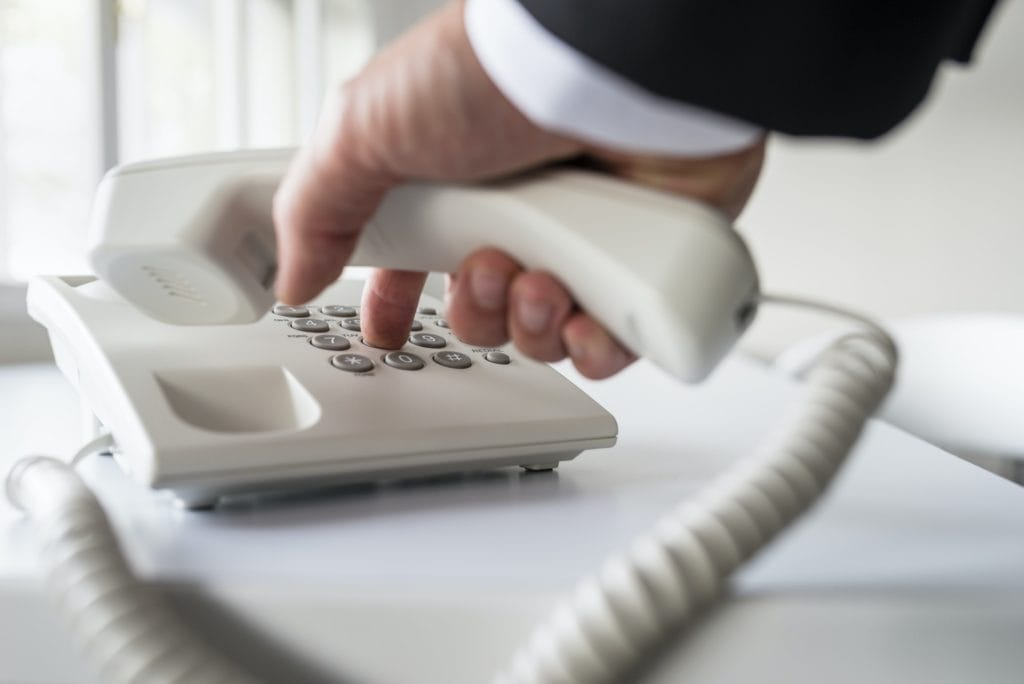 Businessman calling a lawyer to talk about protective orders