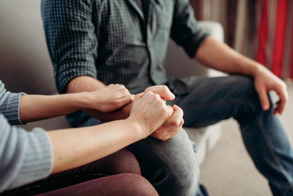 Couple hold hands, counseling with felony lawyers